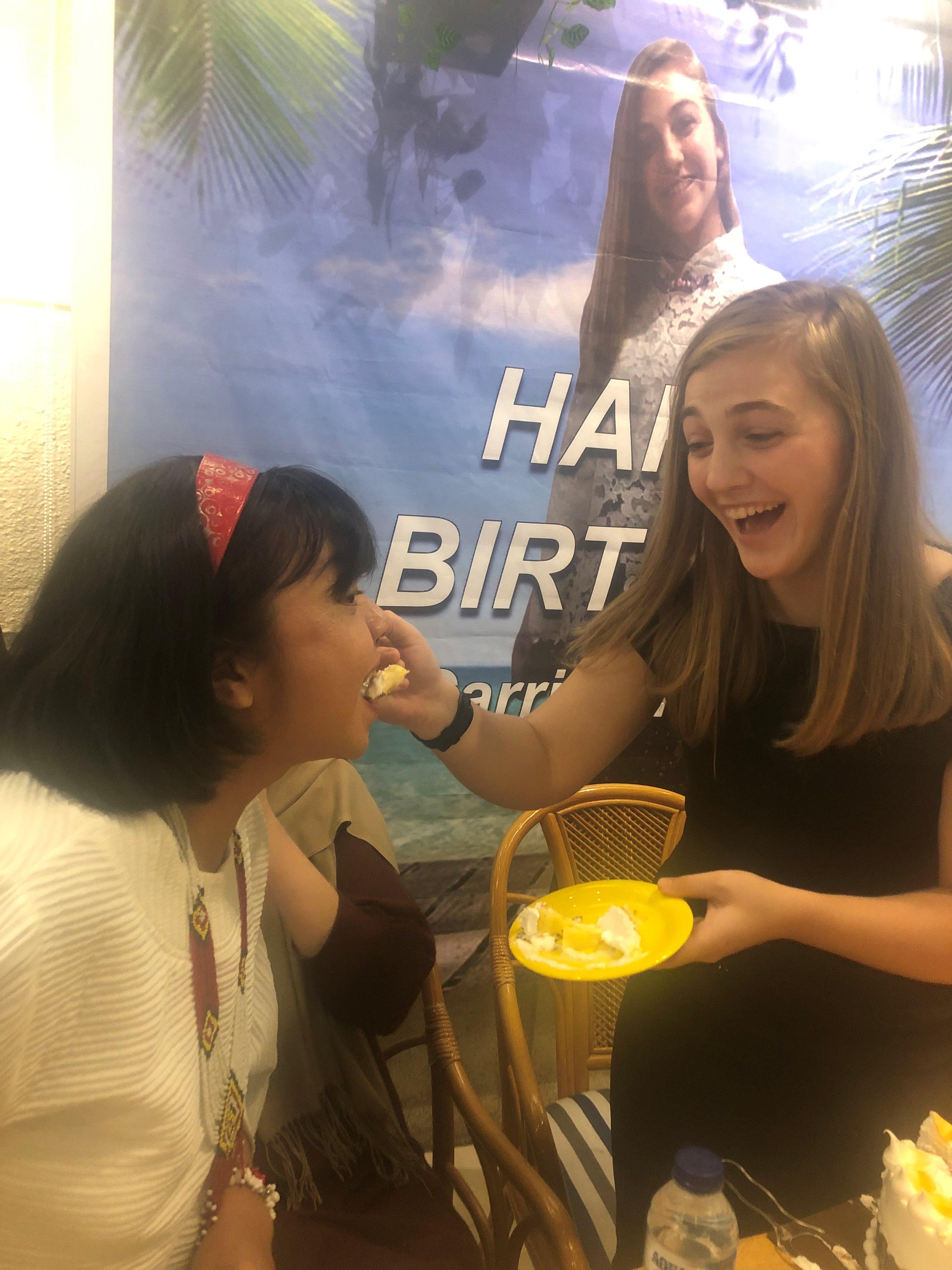 Ina Rice Carrigan Feeding Cake To Friend